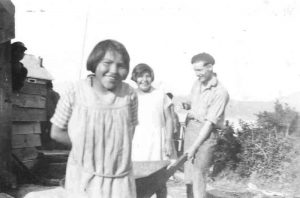Students and Mr. Bailey, bringing coal from the beach, Ahousaht Indian Residential School