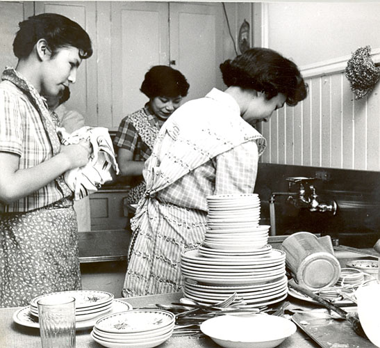 Students washing dishes in the kitchen, Portage la Prairie Indian Residential School.