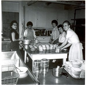 Student making sandwiches in the kitchen, Portage la Prairie Indian Residential School.