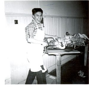 Male student carving turkey, Portage la Prairie Indian Residential School.