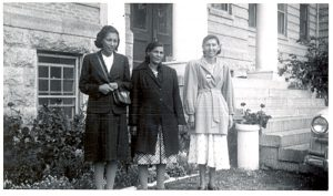 Three women at the August 1952 Homemakers Conference, Portage la Prairie Indian Residential School.