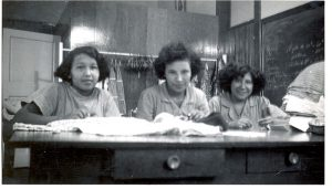Students in the sewing room, Portage la Prairie Indian Residential School.