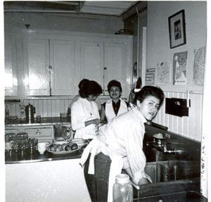 Students cleaning up in the kitchen, Portage la Prairie Indian Residential School.