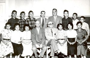 A group of students with government and school officials.