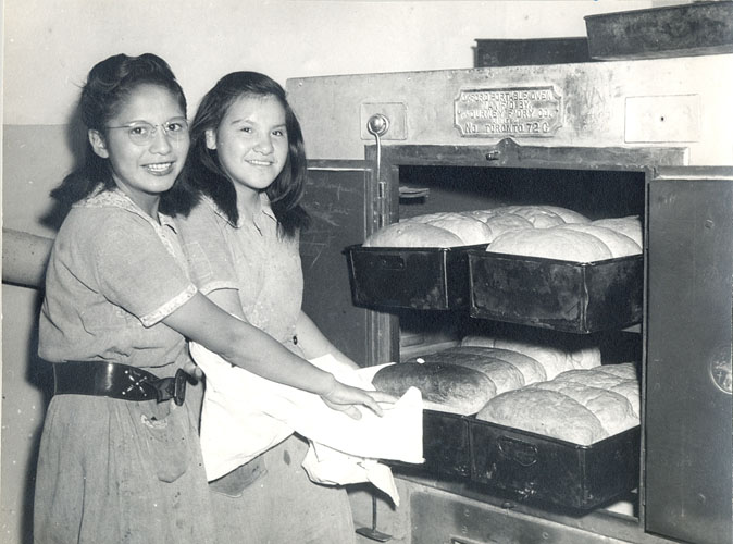Girls baking bread, Portage la Prairie Indian Residential School.