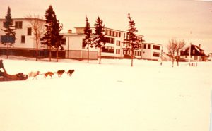 New day school block with dog sled in foreground.