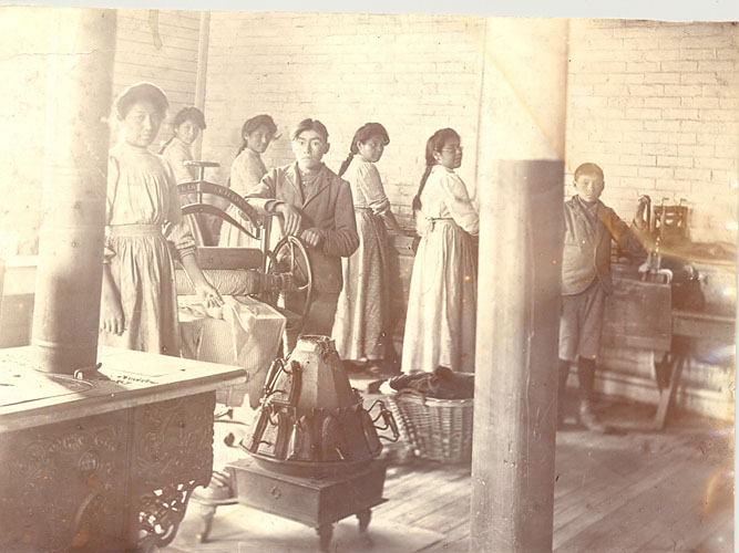 Girls and boys doing laundry, Mount Elgin Institute.