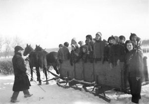 Students on a box sleigh, File Hills Indian Residential School.