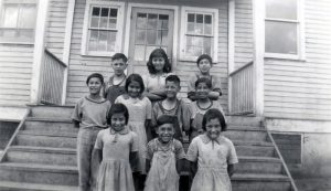 Children on the school steps, Round Lake Indian Residential School.