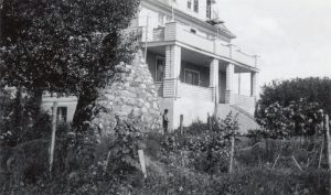 View of the residence and the cairn, Round Lake Indian Residential School.