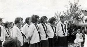Choir leader conducting the Round Lake Indian Residential School school choir.