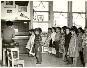 Children performing a song with actions, Norway House Indian Residential School.