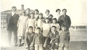 The reverend with children from Cross Lake who attend Norway House Indian Residential School.