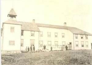 Staff and students assembled outside Norway House Indian Residential School.