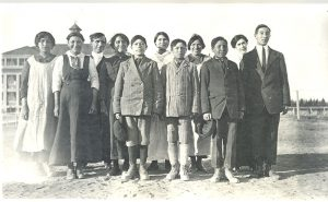 The reverend with children from Oxford House who attend Norway House Indian Residential School.