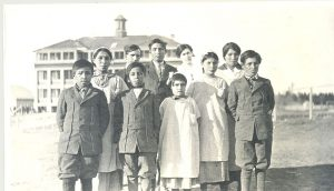 The reverend with children from Poplar River who attend Norway House Indian Residential School.