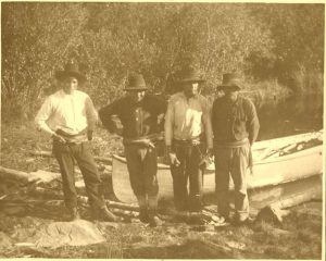 Four Cree guides with their canoe, Norway House.