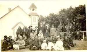Visiting Reverend with women and children of the congregation, Norway House, 1925.