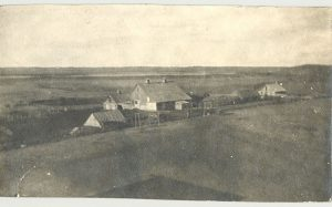 The farm buildings and some of the fields ready for seeding, Spring 1910