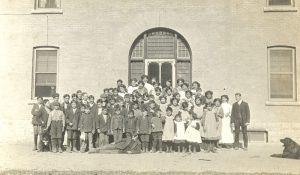 Scholars and staff outside school.