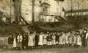 Teacher with her pupils, Crosby Girls' Home, Port Simpson.