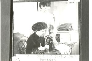 A teacher and a sewing student, Portage la Prairie Indian Residential School.