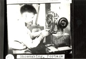 Student in shoemaking class, Portage la Prairie Indian Residential School.