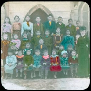 Teacher and pupils of day school, Port Simpson.