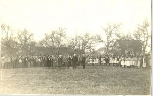 Moderator Right Rev. T.A. Moore plants a tree, Coqualeetza Institute, 1932.