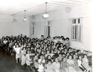 Girls in the Assembly Hall of the Alberni Indian Residential School, circa 1960.
