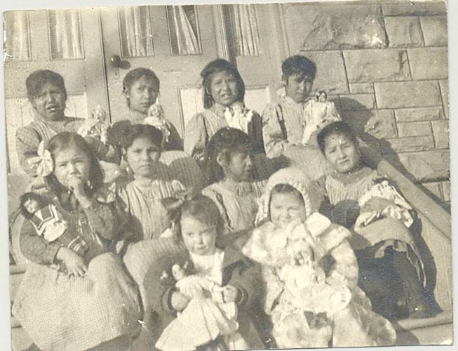 Young pupils at Red Deer Institute. Each girl has a doll which came as presents from the East.