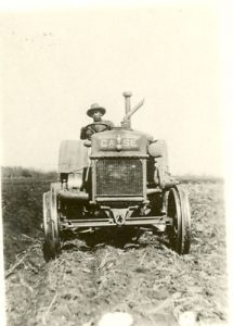Student ploughing with the tractor, Edmonton Indian Residential School.