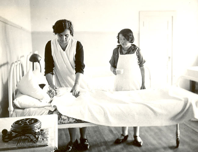 Student assists nurse in caring for sick boy, Edmonton Indian Residential School.