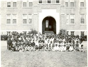 Students in front of school.