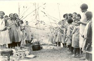 Girls at a weiner roast, Edmonton Indian Residential School.