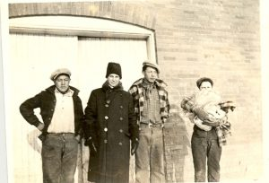 A teacher and three students, Edmonton Indian Residential School.