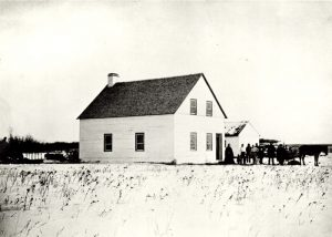 Mr. and Mrs. George McDougall and others standing beside the Methodist mission house, Edmonton.