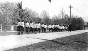 Girls walking on road, Alberni Indian Residential School