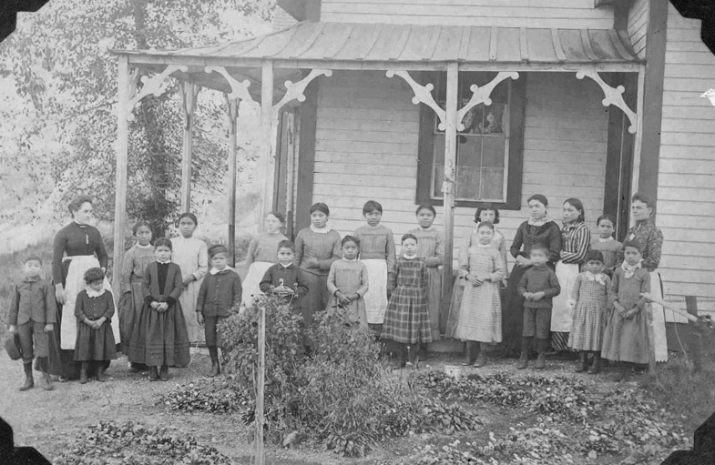 The first Crosby Girls' Home, resident and staff.